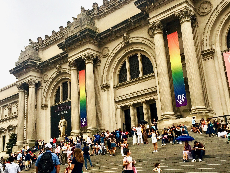 Metropolitan Museum of Art in New York City with rainbow banners honoring LGBYQ Pride