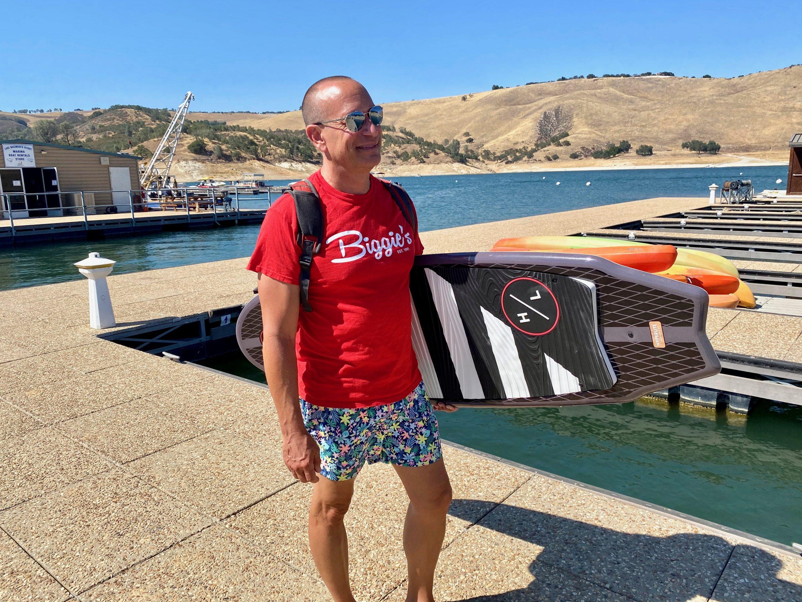 Man holding wake surfboard at Lake Nacimiento, CA