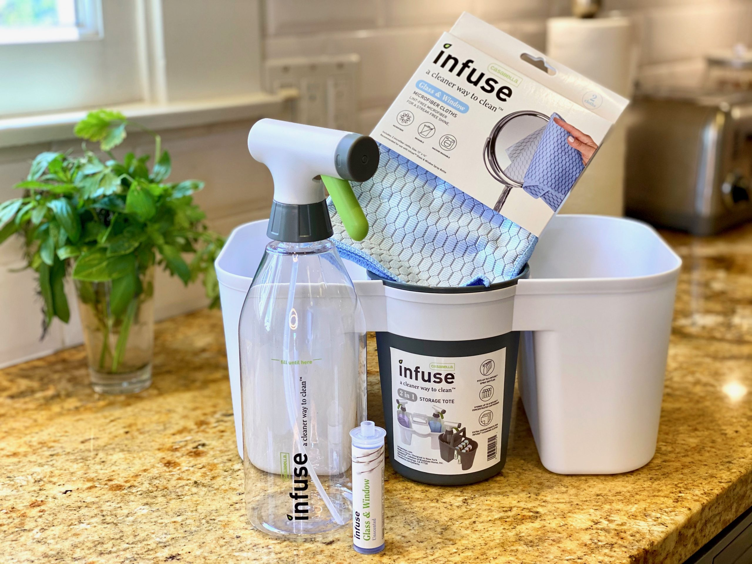 Infuse Cleaning System caddy on kitchen counter with golden granite countertop