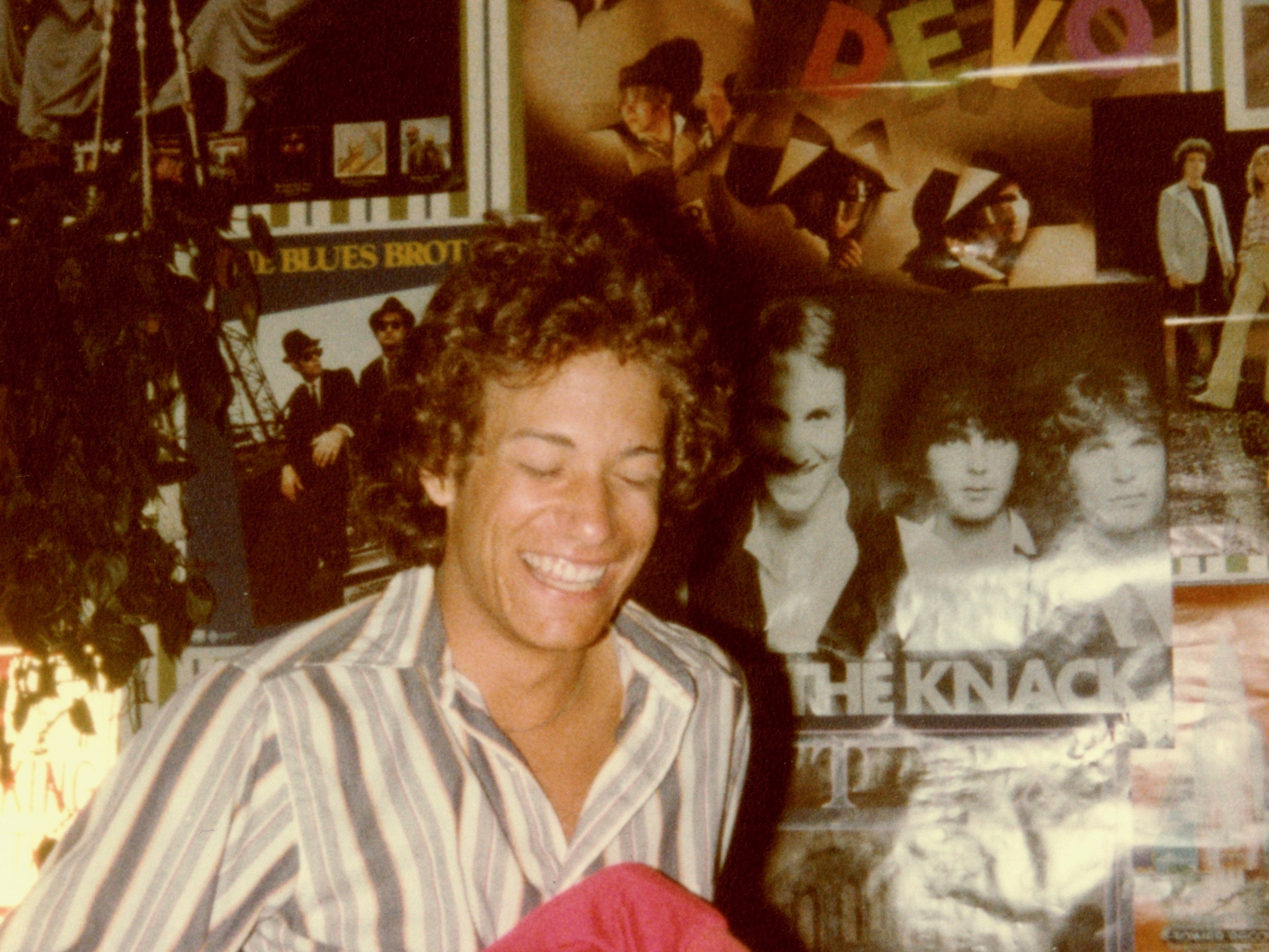 high school boy in 1981 with lots of rock and roll band posters