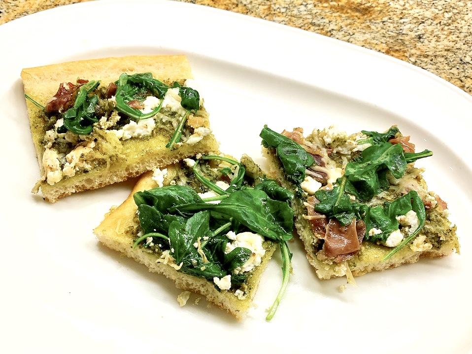 Pesto Flatbread with Prosciutto, Goat Cheese and Arugula