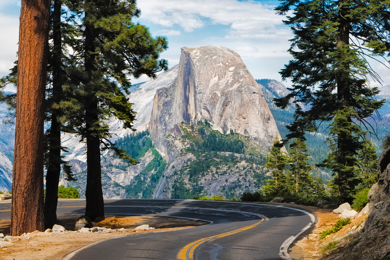 The road leading to Glacier Point in Yosemite National Park, California, USA with the Half Dome in the background.