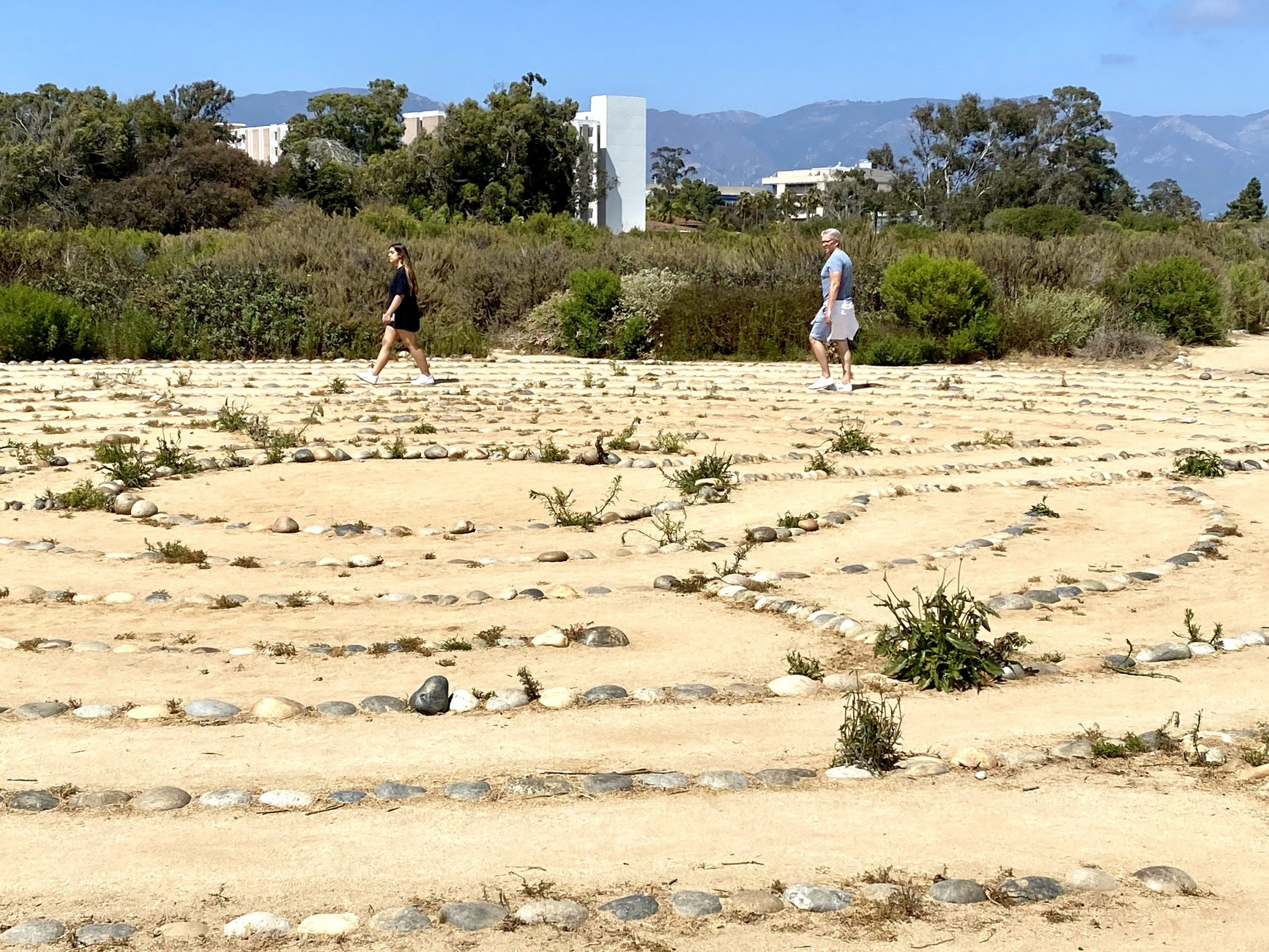 Father and daughter walking the labyrinth on the UCSB campus in Goleta, CA