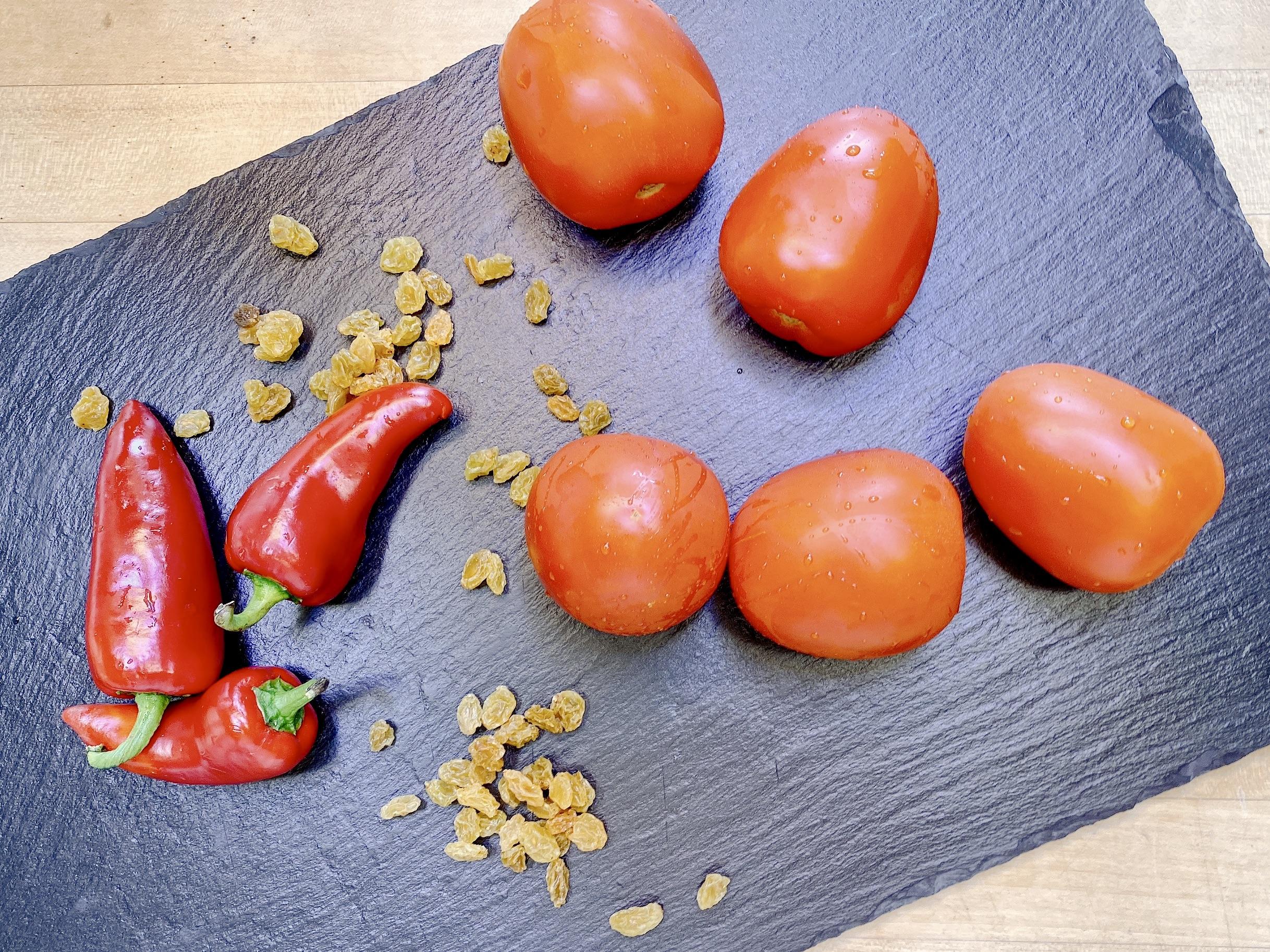 tomatoes, Fresno chiles and golden raisins