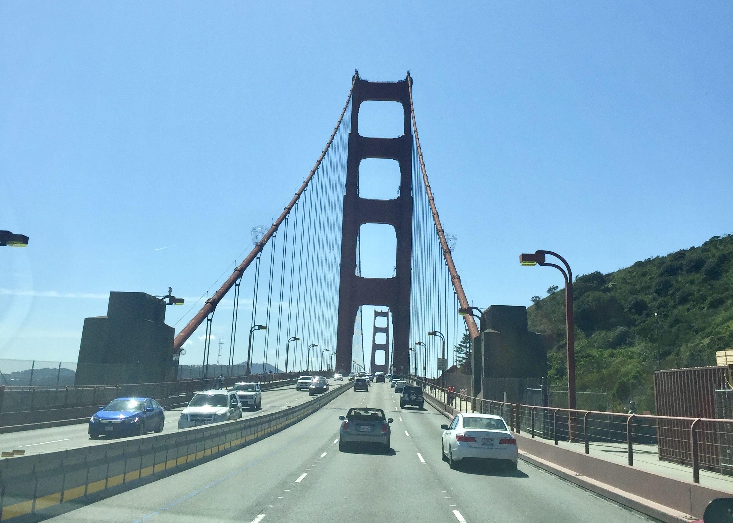 Driving across the Golden Gate Bridge, taken through the windshield of the car at street level