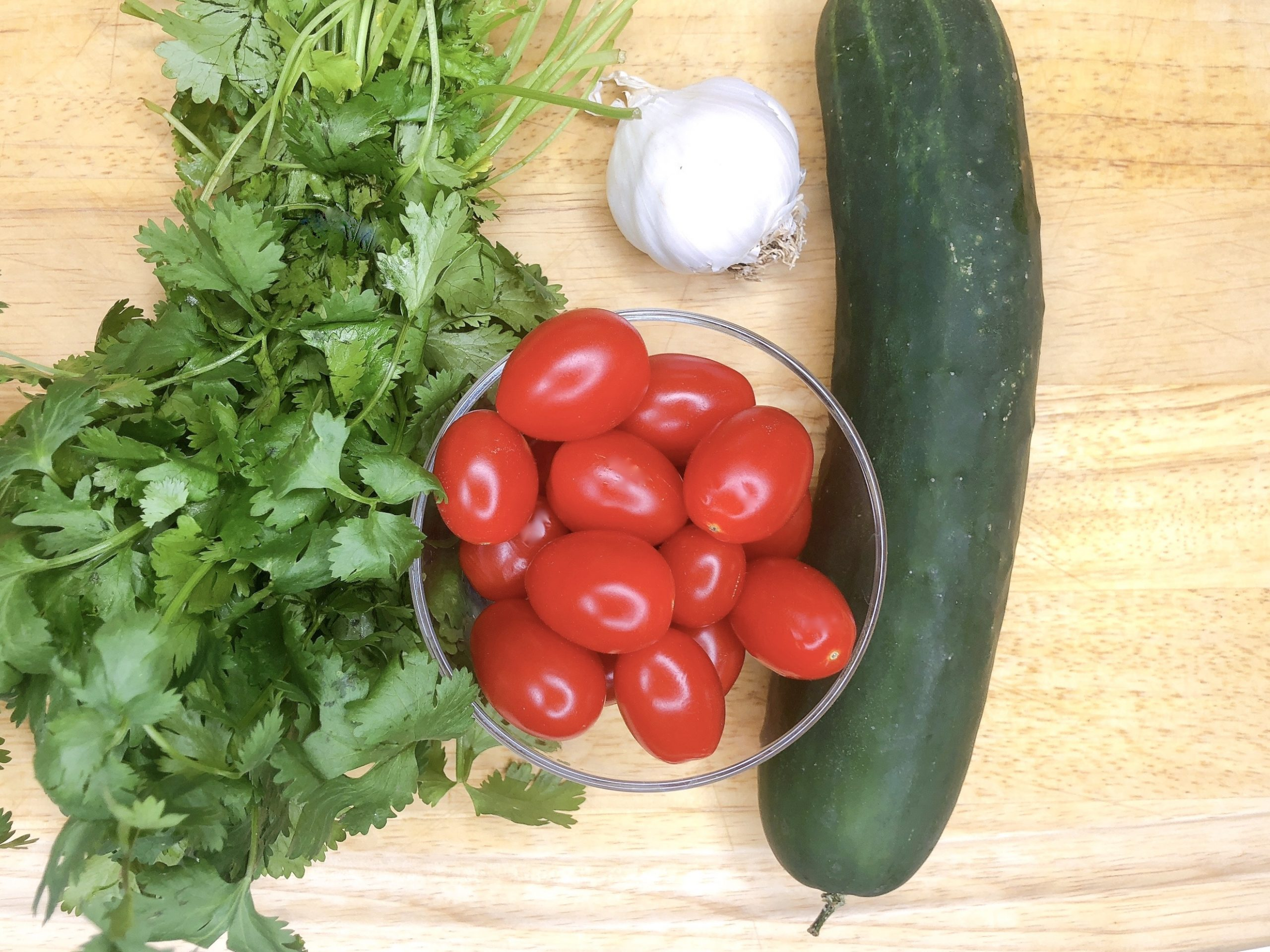 fresh cucumber, tomatoes, garlic and cilantro
