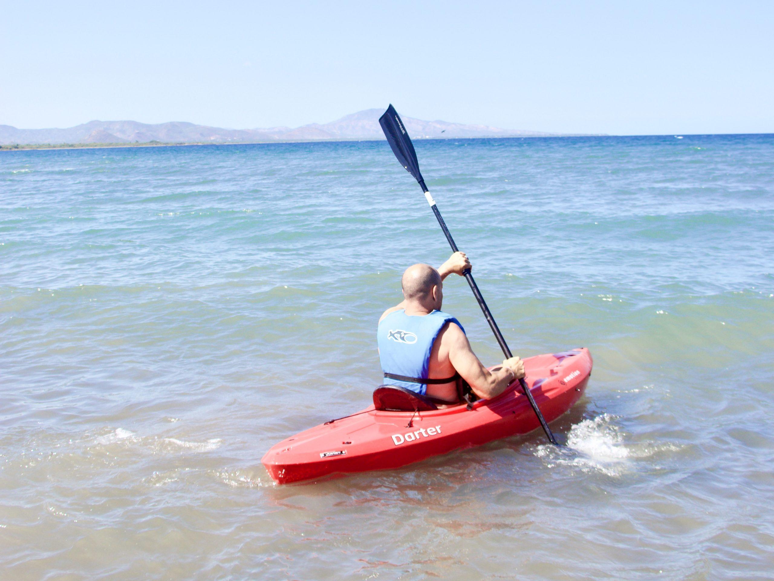 Man kayaking on Sea of Cortez in Loreto, Mexico