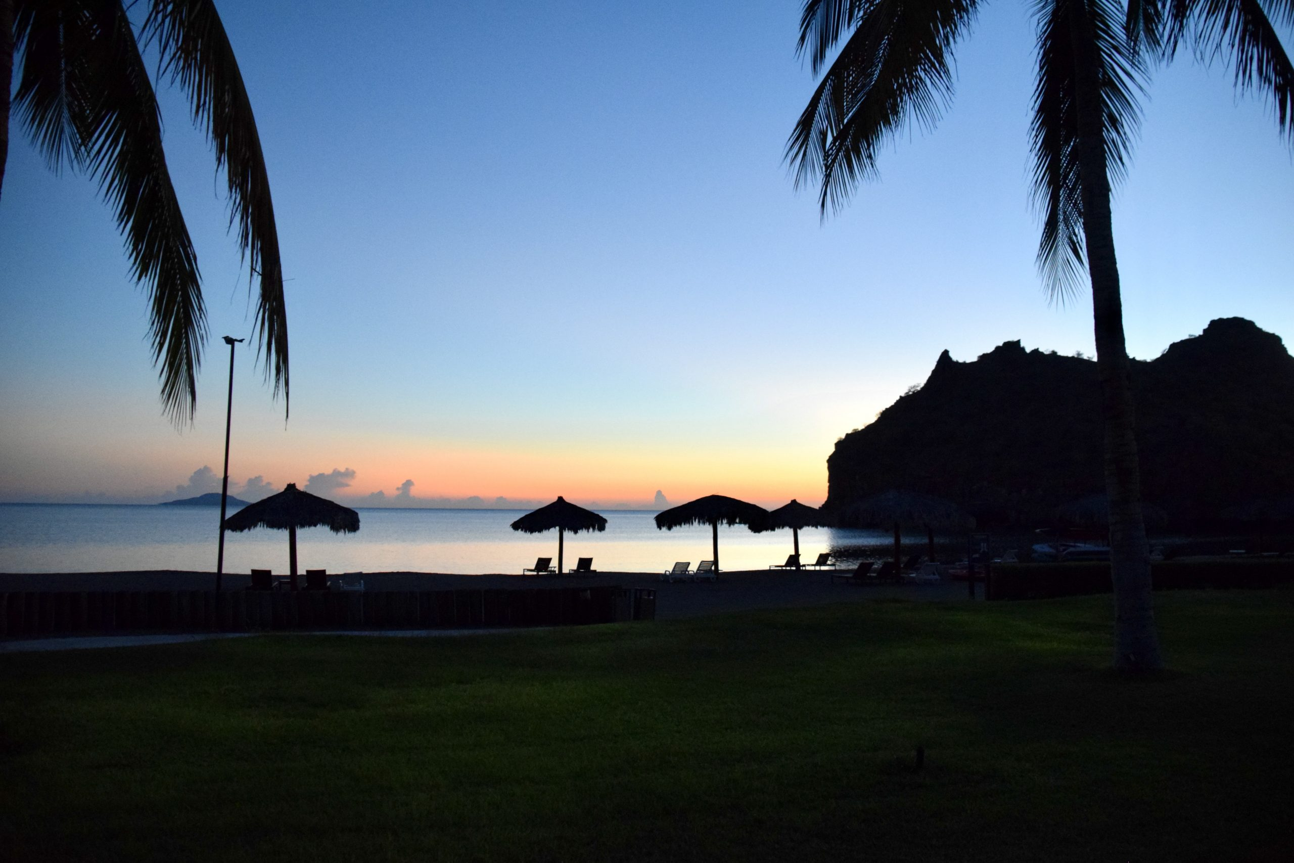 sunrise with beach palapas along the coast of Loreto, Mexico