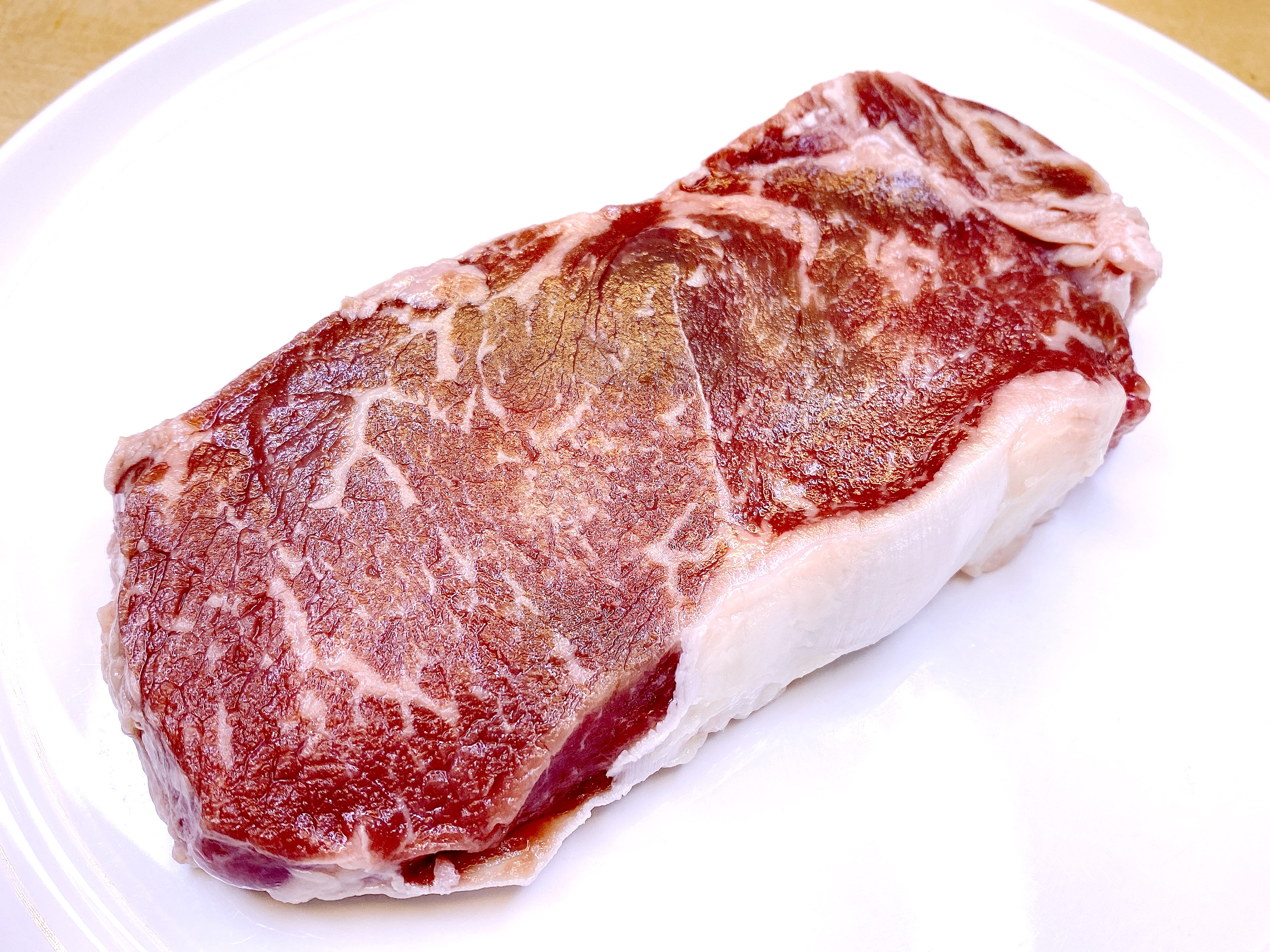 Raw steak Angus Beef Strip Steak from NIman Ranch and Perdue Farms.