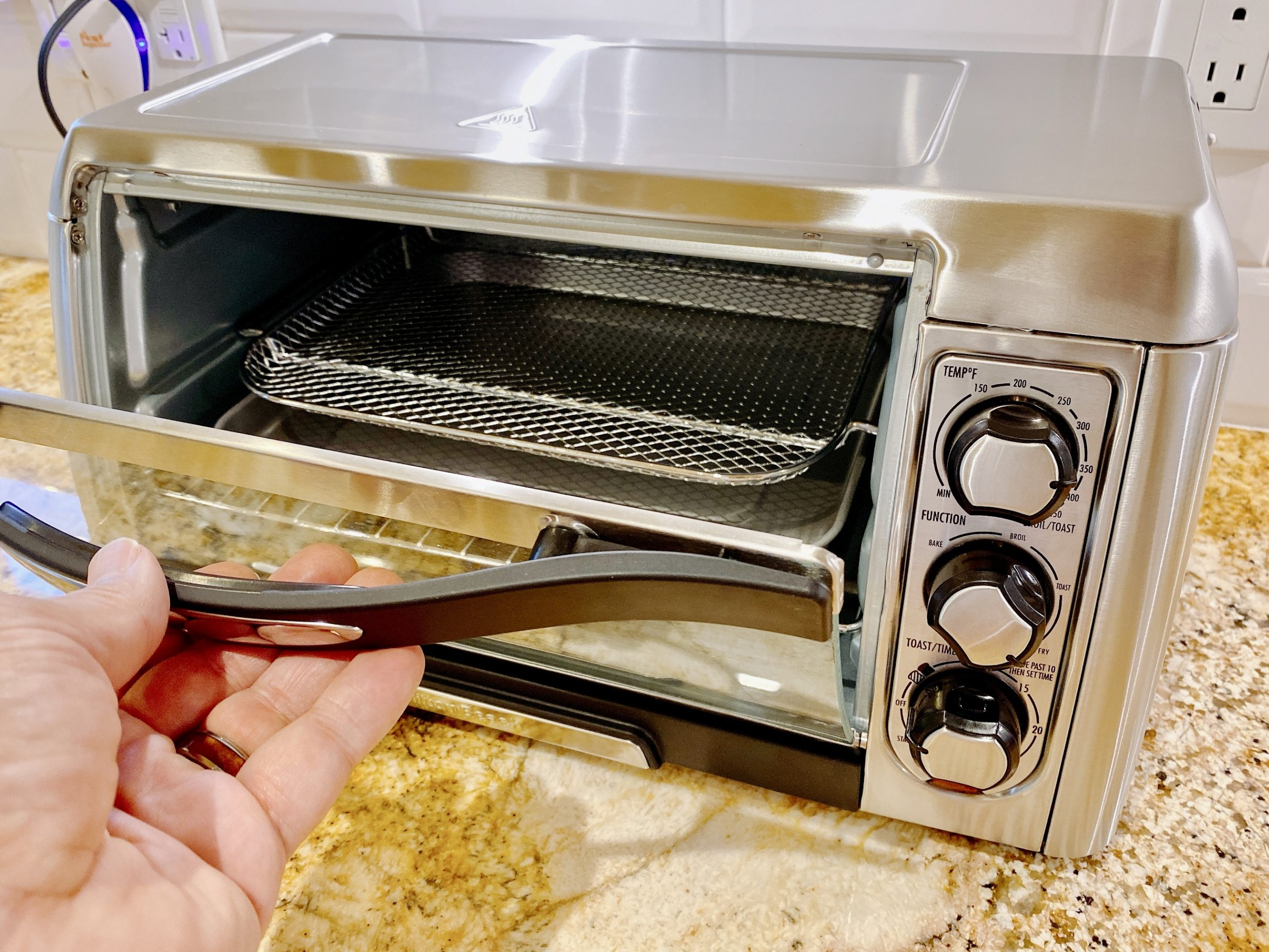 The Hamilton Beach Sure-Crisp Air Fry Toaster Oven has a large door with glass