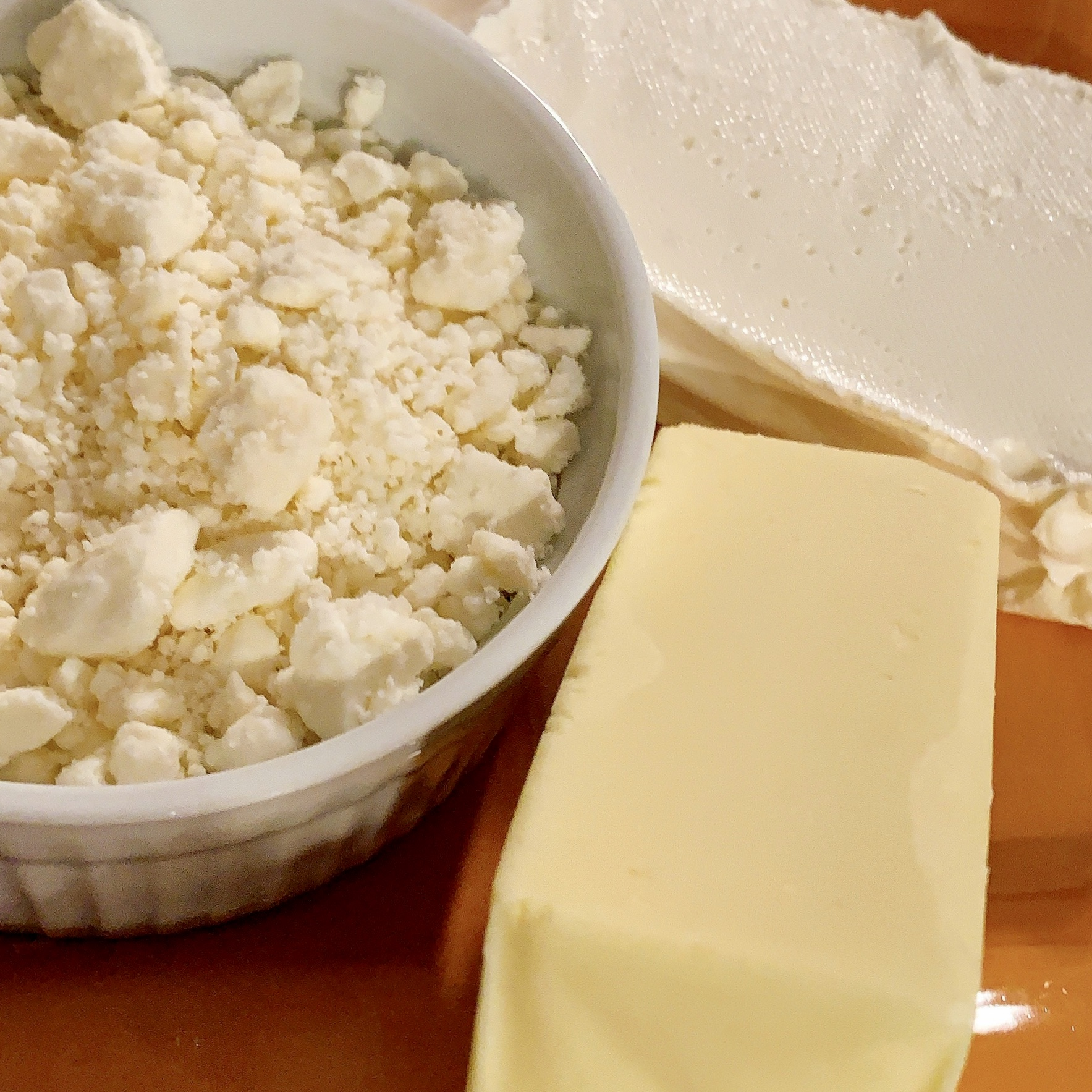 feta cheese, butter and cream cheese are ingredients in the recipe for Feta Phyllo Triangles.