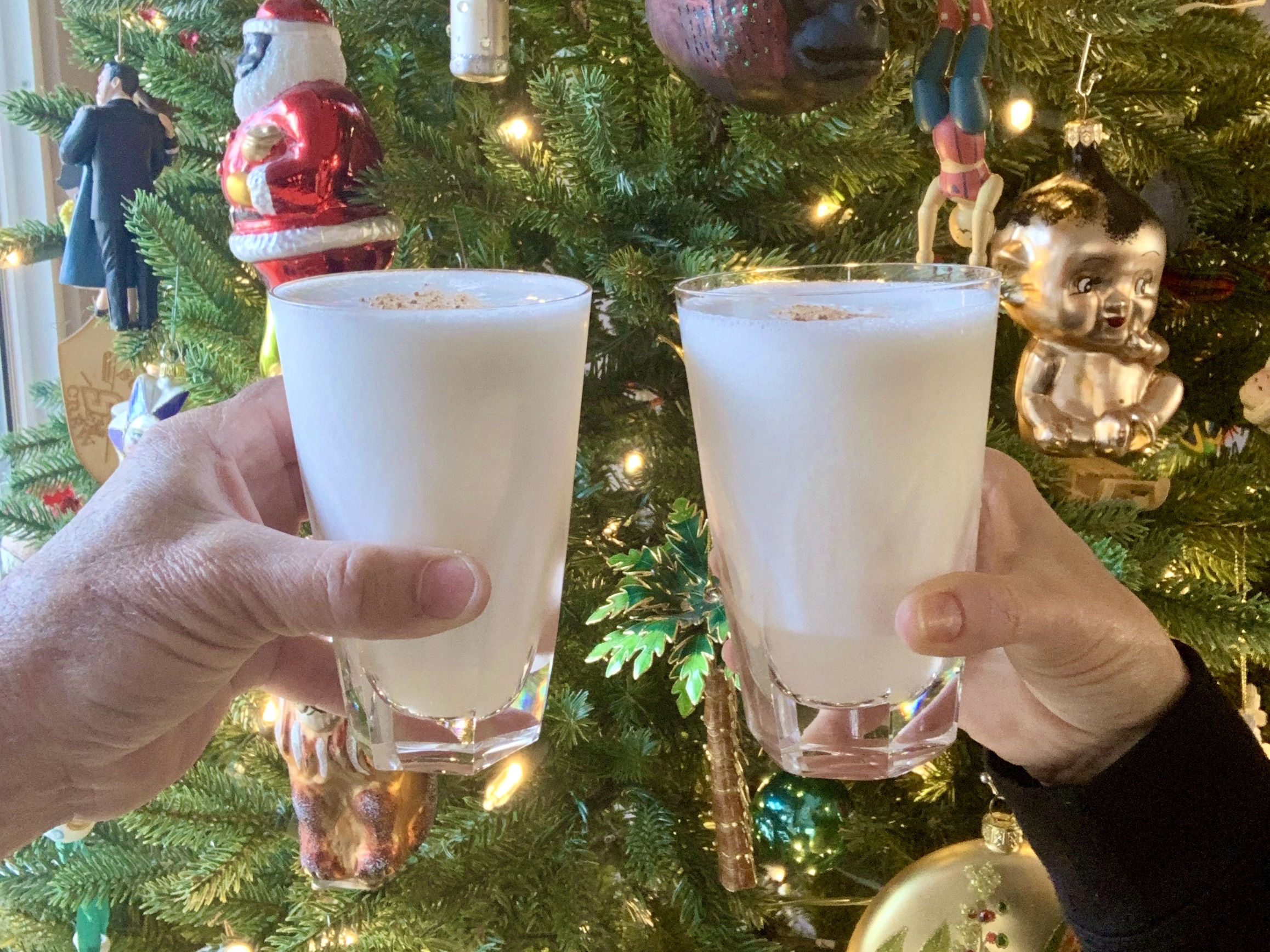 two gin fizzes in front of Christmas Tree