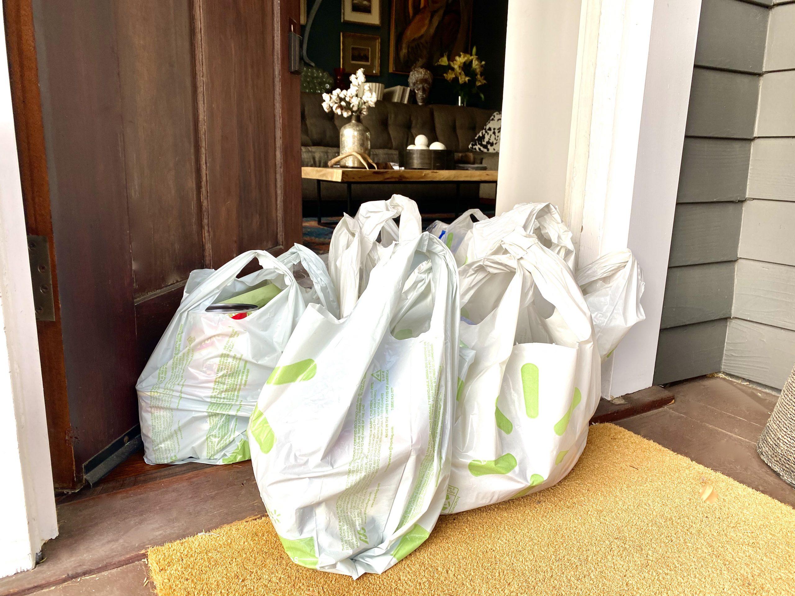 Walmart bags at front door of house