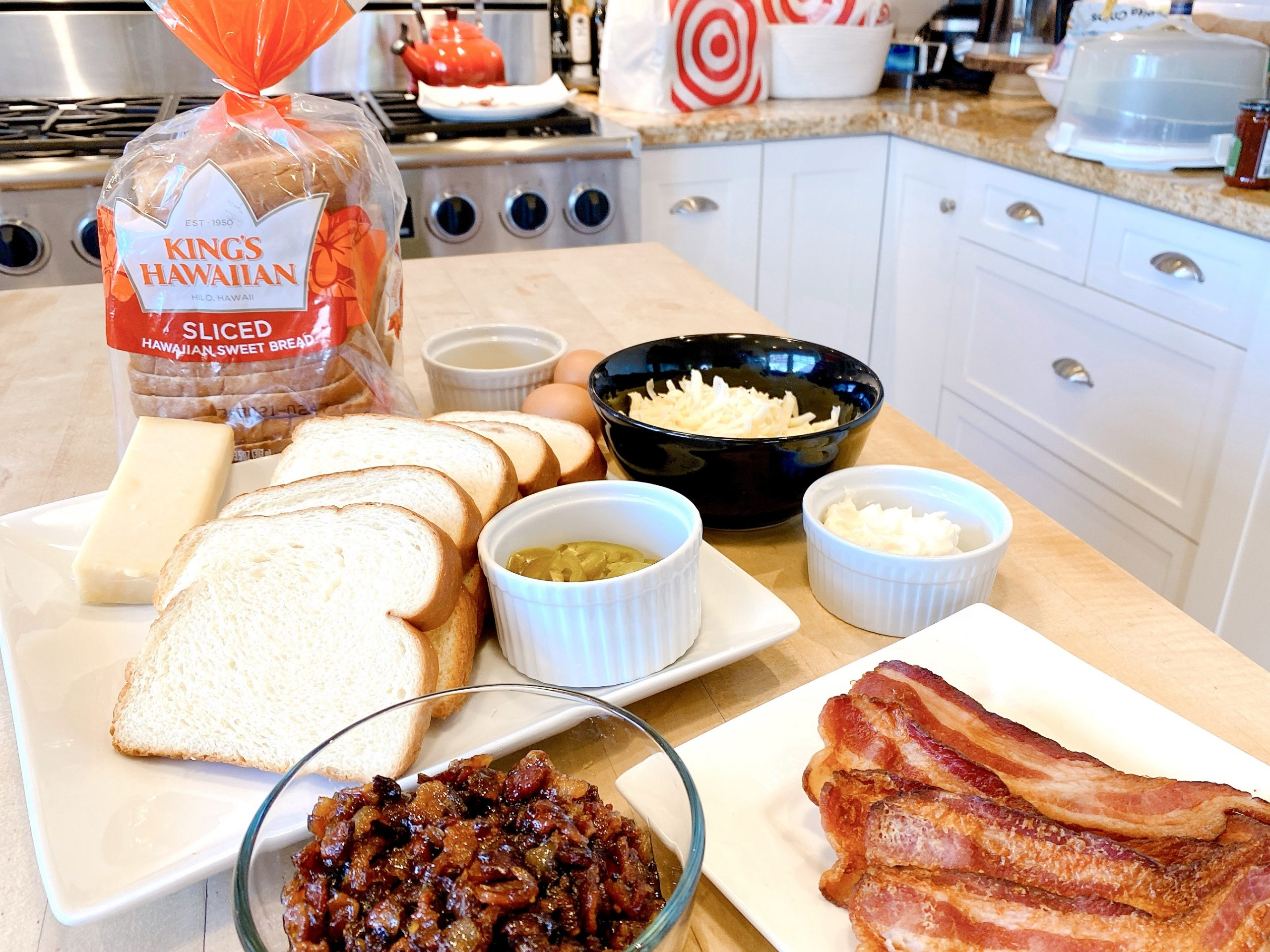 ingredients to make Monte Cristo sandwich including King's Hawaiian Sliced Sweet Bread, cheese, mayonnaise, mustard, bacon jam and bacon