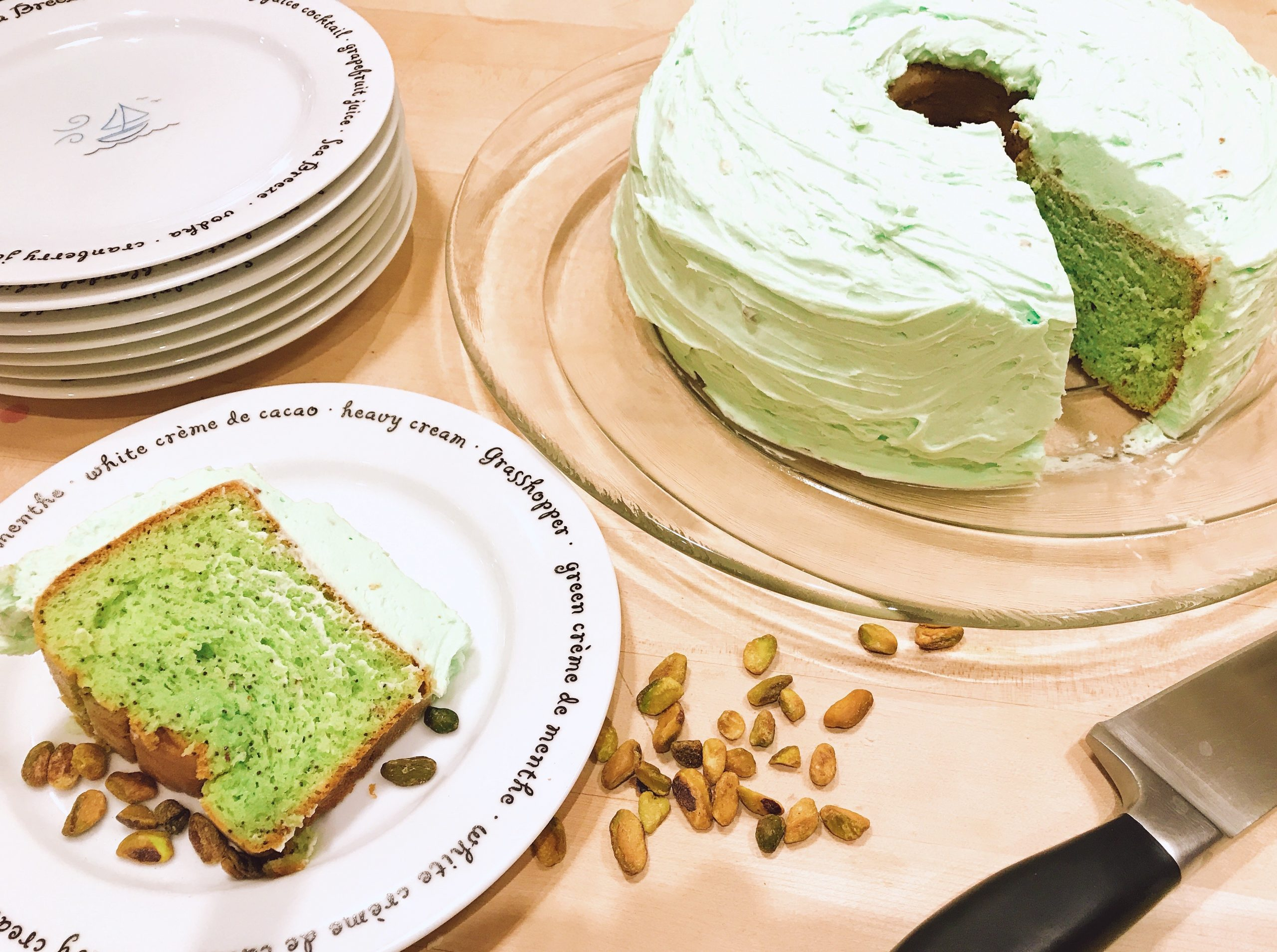 Pistachio Pudding Cake with Green Whipped Cream Frosting and salted pistachios