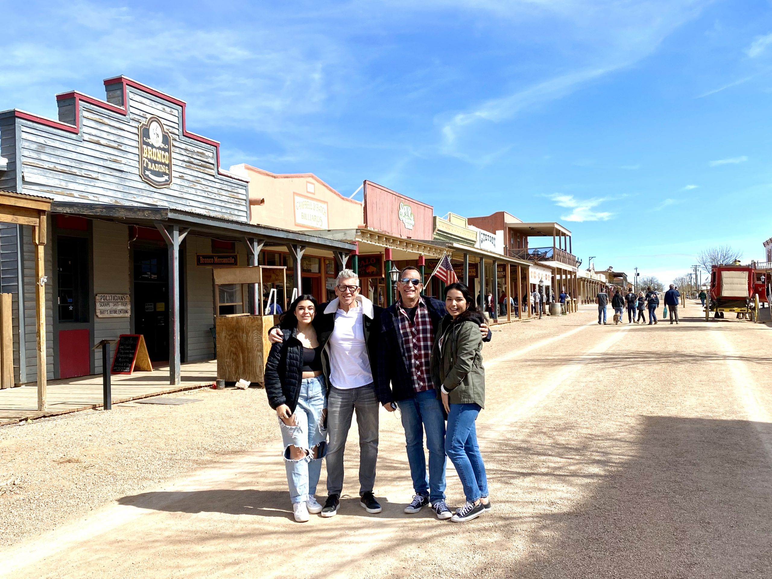 family with two dads and two daughters on the historic main avenue in the Old West town of Tombstone, Arizona
