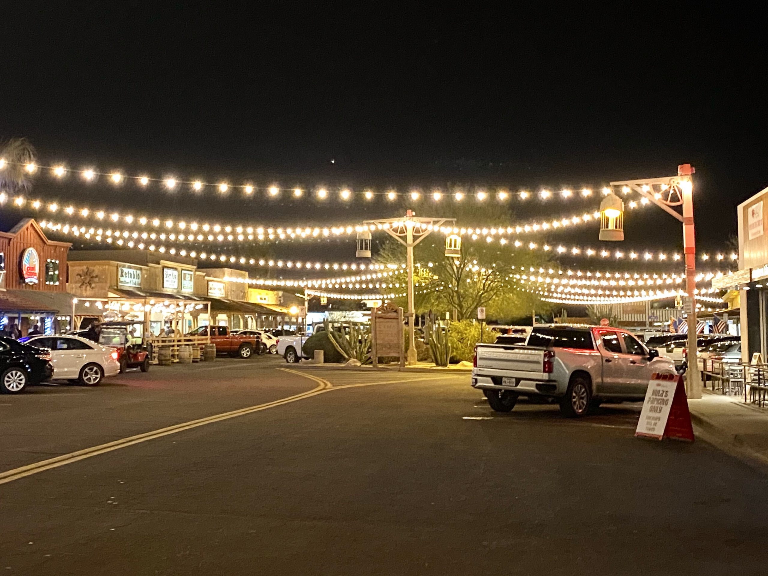 Festive streetlights cross the boulevards in historic downtown Old Town Scottsdale, Arizona