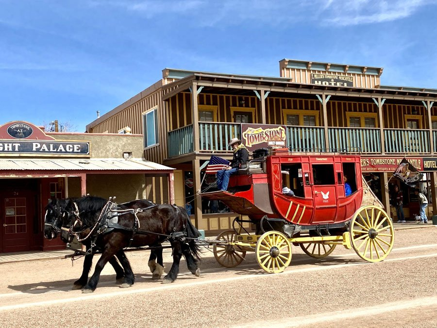 Historic Wells Fargo Stagecoach pulled by horses down the main boulevard in Tombstone, Arizona
