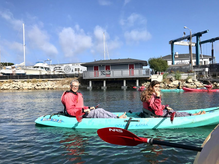 Father and daughter kayak the waters of Monterey Bay