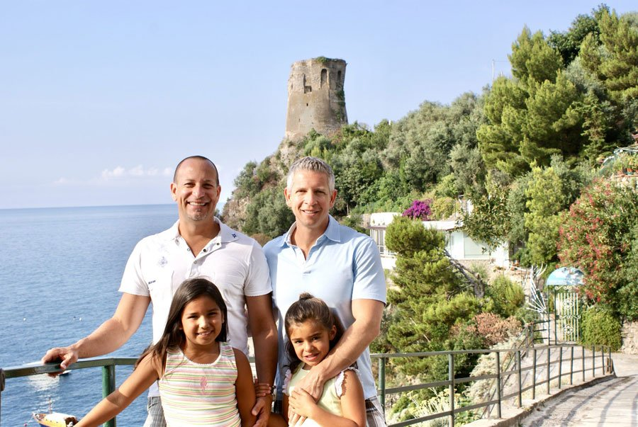 family with two dads and two daughters on the Amalfi Coast, Italy