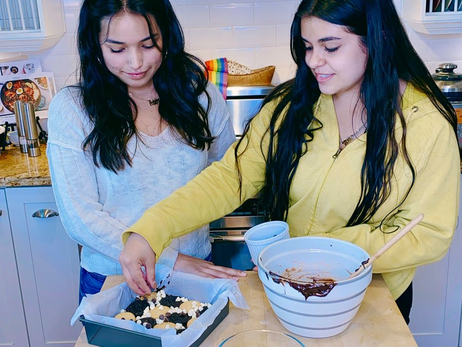 Recipe for OREO Tuxedo Brownies made by two girls.