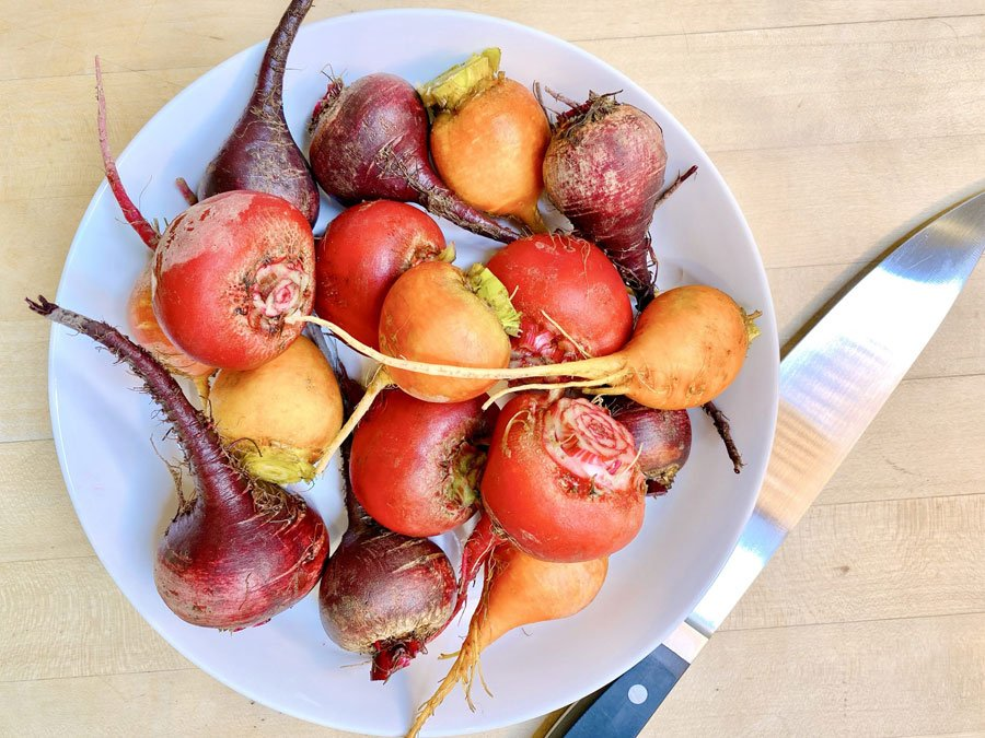 bowl full of fresh colorful beets trimmed and ready for roasting