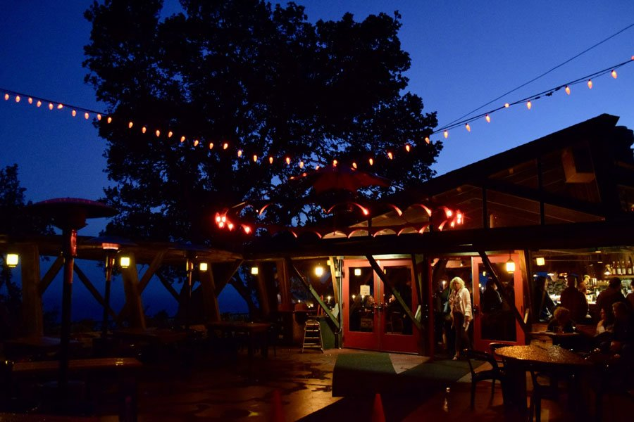 Night falls on the front entrance of Nepenthe restaurant in Big Sur, CA