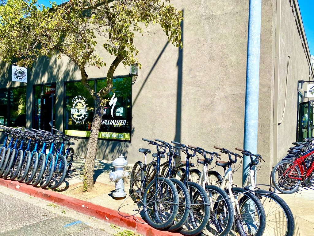 Bicycle rentals and bicycles lined up in front of Napa Valley Bike Shop in Downtown Napa, California.