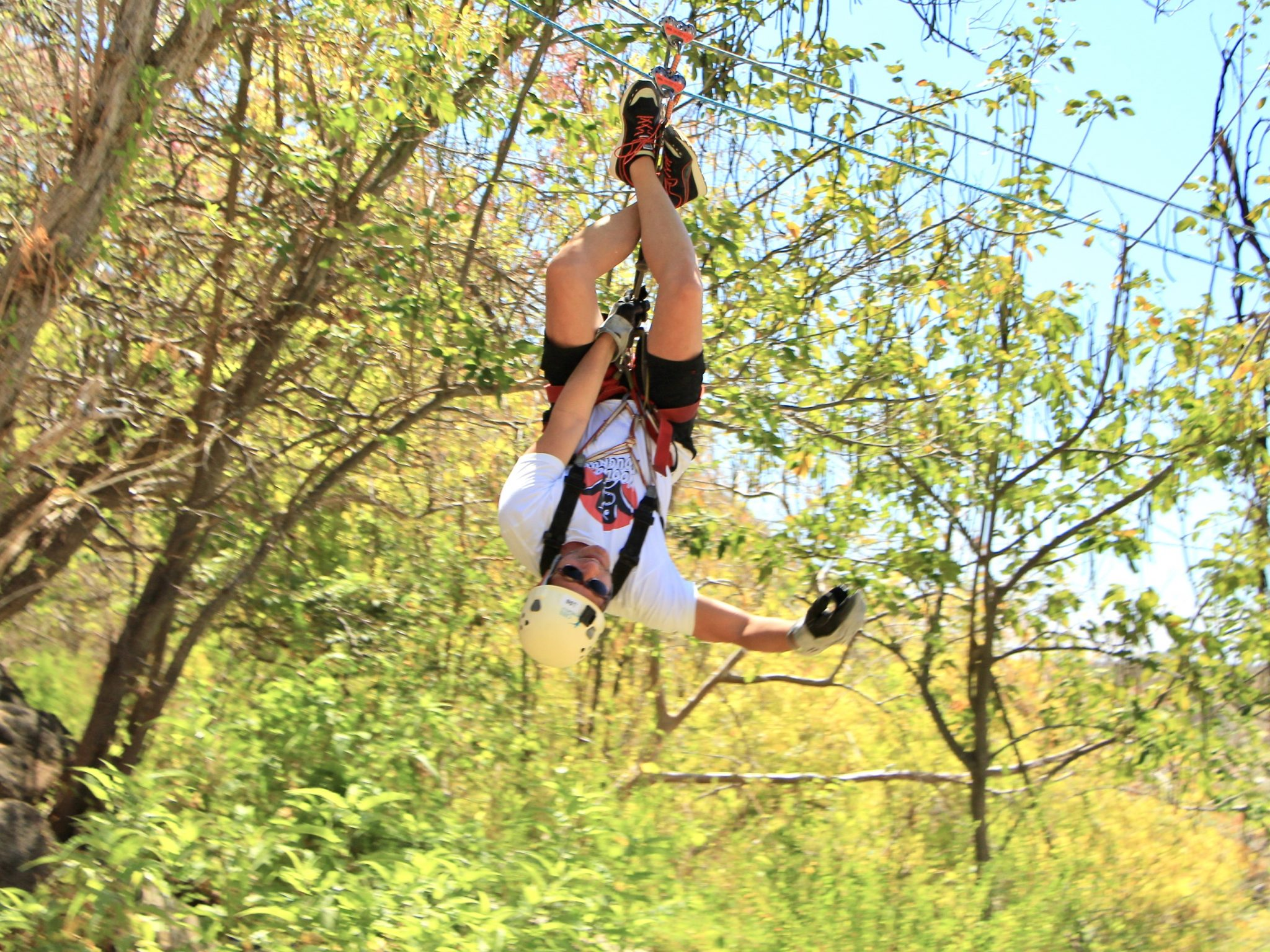 Man hangs upside down in perilous and fun zipline experience with Cabo Adventures in Los Cabos, Mexico