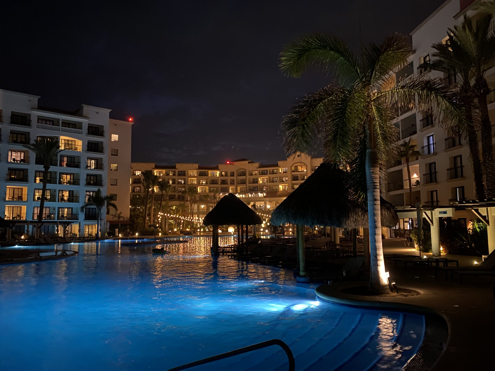 Night shot taken from main pool looking back at lobby building and rooms at Hyatt Riva Resort in Los Cabos, Mexico