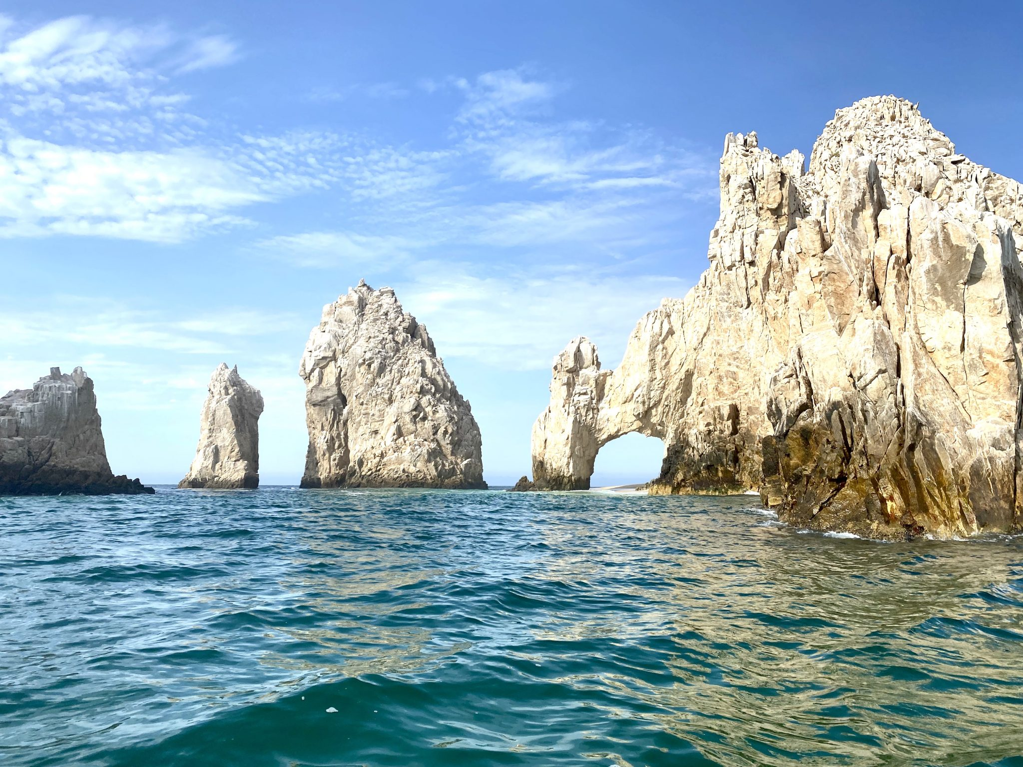 Los Arcos rock formations with arches and caves at the tip of Baja California in Cabo San Lucas, Mexico